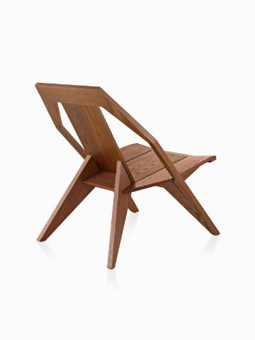 Three-quarter rear view of a wood Mattiazzi Medici outdoor chair in a medium finish.