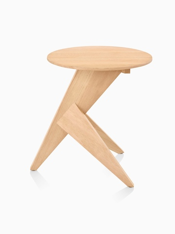Profile view of a Mattiazzi Medici occasional table with a round top and angular tripod base.