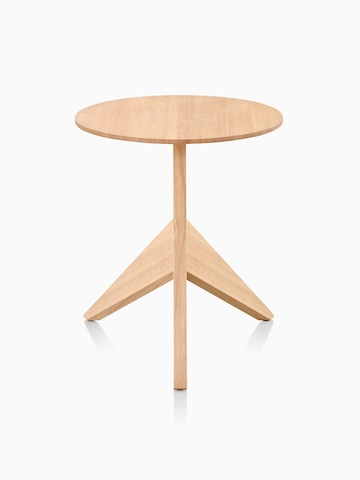 A Mattiazzi Medici occasional table with a round top and angular tripod base, viewed from the front.