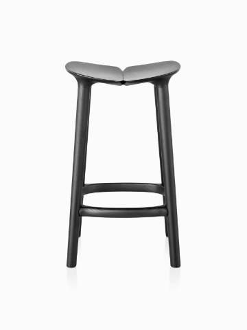 A tall Mattiazzi Osso wood stool with a black finish, viewed from the front.