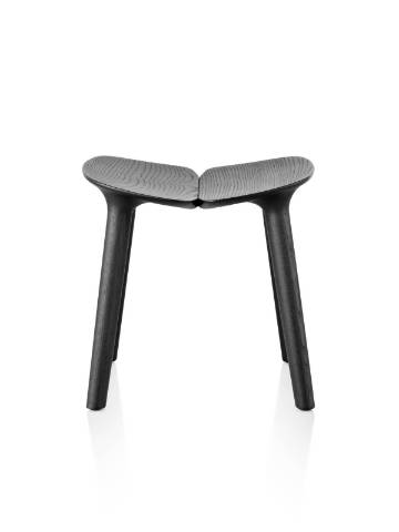 A low Mattiazzi Osso wood stool with a black finish, viewed from the front.