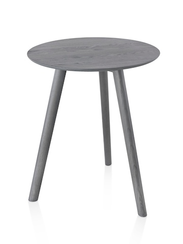 A wood Mattiazzi Osso Table with a round top.
