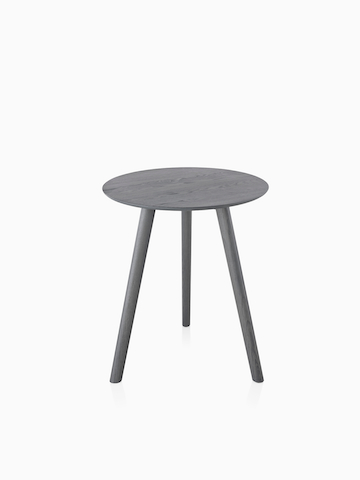 A small round Mattiazzi Osso Table with a gray top.