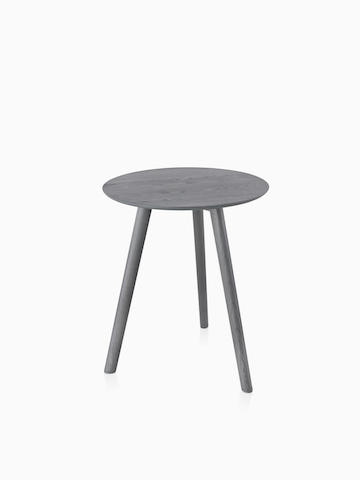 A small round Mattiazzi Osso Table with a gray top. Select to go to the Mattiazzi Osso Tables product page.