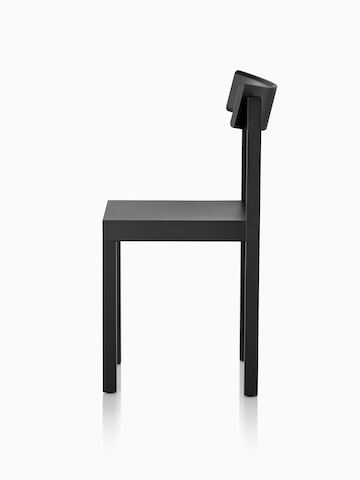 Profile view of a black Mattiazzi Primo stacking chair.