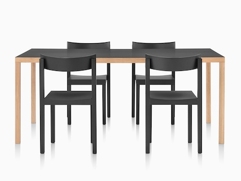 Four black Mattiazzi Primo stacking chairs around a Mattiazzi Primo dining table with a black top.
