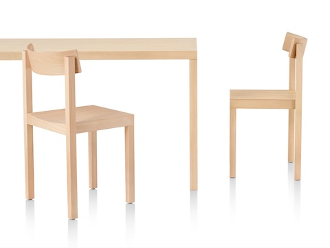 A rectangular Mattiazzi Primo Table and two Mattiazzi Primo Chairs, all with a light wood finish.