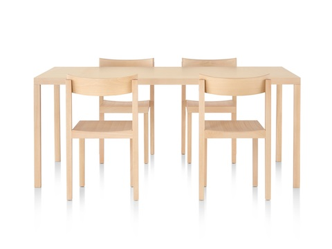 A rectangular Mattiazzi Primo Table and four Mattiazzi Primo Chairs, all with a light wood finish.