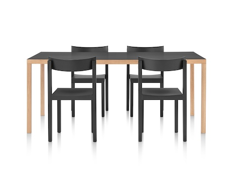 A rectangular Mattiazzi Primo Table with a black top and contrasting wood legs, joined by four black Mattiazzi Primo Chairs.