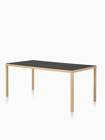 A rectangular Mattiazzi Primo Table with a black top. Select to go to the Mattiazzi Primo Table product page.