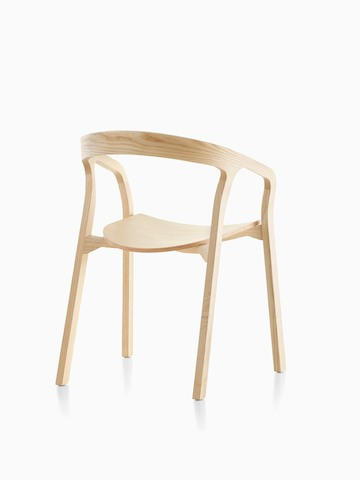 Three-quarter rear view of a wood Mattiazzi She Said stackable side chair with a light finish.
