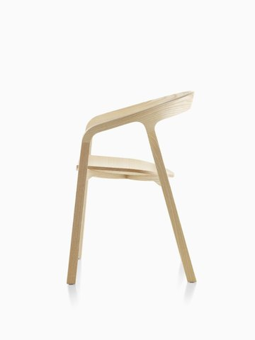 Profile view of a wood Mattiazzi She Said stackable side chair with a light finish.