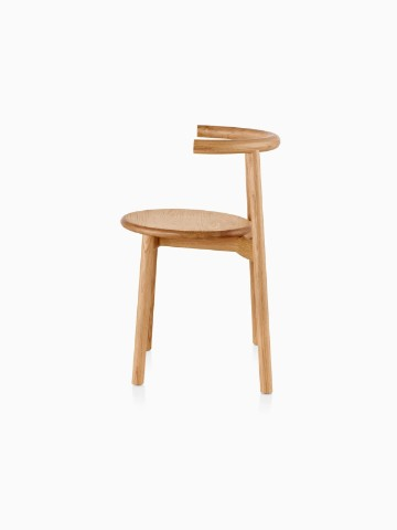Profile view of a wood Mattiazzi Solo side chair with a light finish.