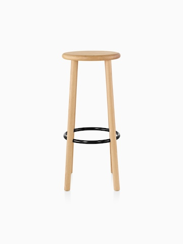 Mattiazzi Solo Stool with a light wood finish on the seat and legs and a black footrest.