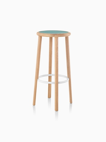 Mattiazzi Solo Stool with a green upholstered seat, white footrest, and light wood finish on the legs, viewed from an angle.