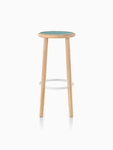 Mattiazzi Solo Stool with a green upholstered seat, white footrest, and light wood finish on the legs.