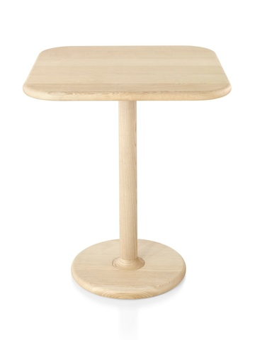 A Mattiazzi Solo occasional table with a rounded rectangular top and round base.