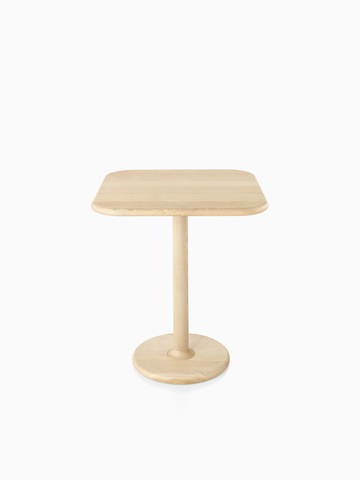 A rounded square Mattiazzi Solo Table with a light wood finish. Select to go to the Mattiazzi Solo Tables product page.