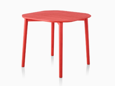 A rounded square Mattiazzi Tronco Table with a red stain.