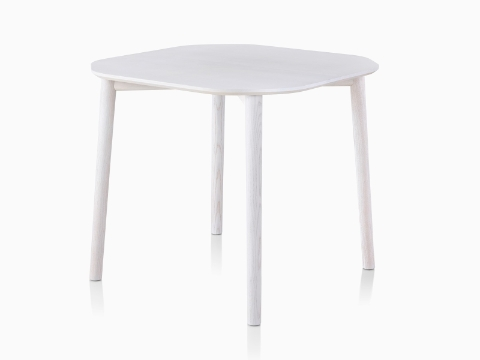 A rounded square Mattiazzi Tronco Table with a white stain.
