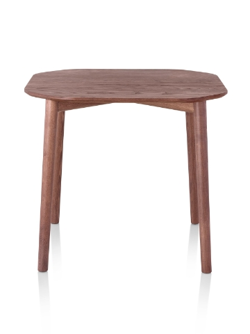 A rounded square Mattiazzi Tronco Table with a medium wood stain.