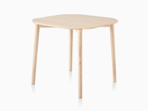 A rounded square Mattiazzi Tronco Table with a light ash finish.