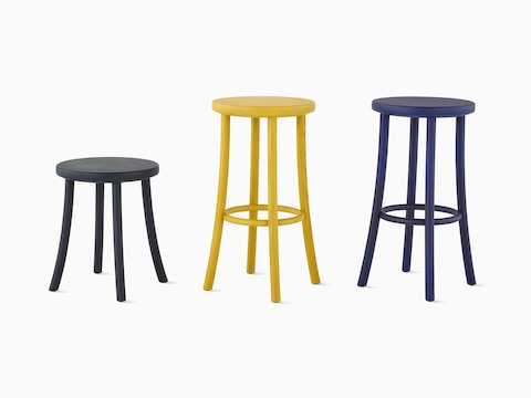 Three Mattiazzi Zampa Stools in varying heights and wood finishes.
