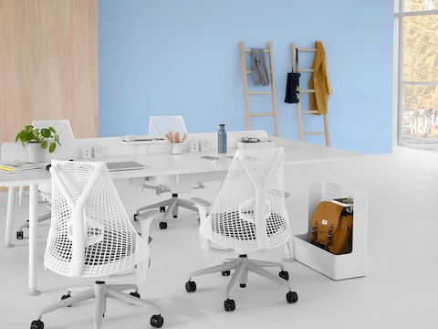 A white Memo project table with white Sayl office chairs.