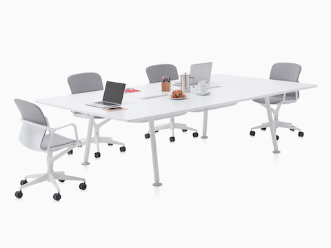 A rectangular Memo table surrounded by grey Keyn side chairs.