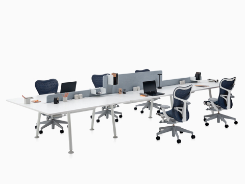 Blue Mirra 2 office chairs paired with white Memo benching surfaces separated by a light grey screen.
