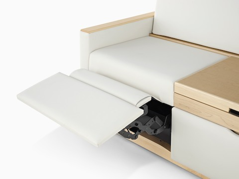 Partial view of an off-white Merge Flop Sofa, showing the optional footrest in the extended position.