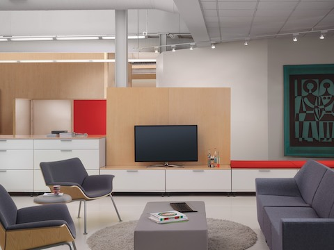 Meridian lateral files serve as a focal point, supporting a television and offering cushion-top seating.