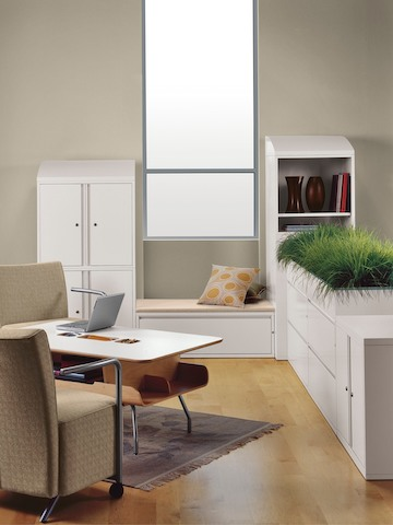 Meridian storage cases create boundaries for a casual collaboration area.