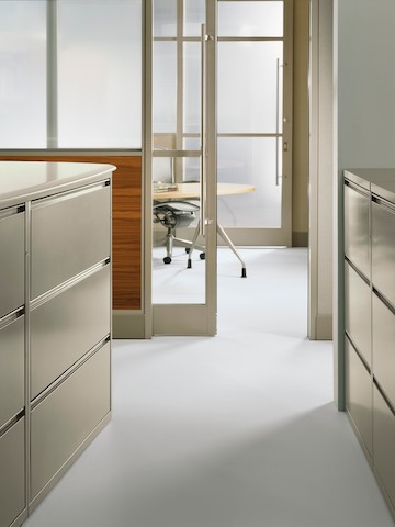 Beige Meridian three-high lateral files face each other to create an aisleway.