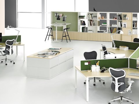 Six white Meridian storage units are placed together to create a collaborative workspace within an open workspace.