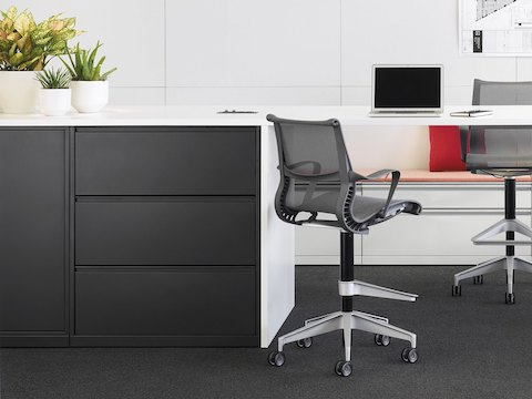 Meridian storage units with standing-height worktop and Setu stools.