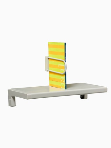 A small shelf holds an upright catalog. Select to go to the Mini-Shelf product page.