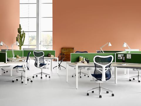 Blue Mirra 2 office chairs paired with project team tables from the Layout Studio office furniture system.