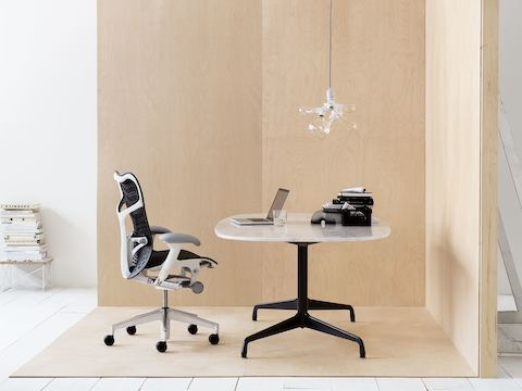 Black Mirra 2 office chair with an Eames oval table.