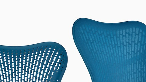 Two blue Mirra 2 office chairs showing the two available back options: Tri-Flex Back and fabric-covered Butterfly Back.
