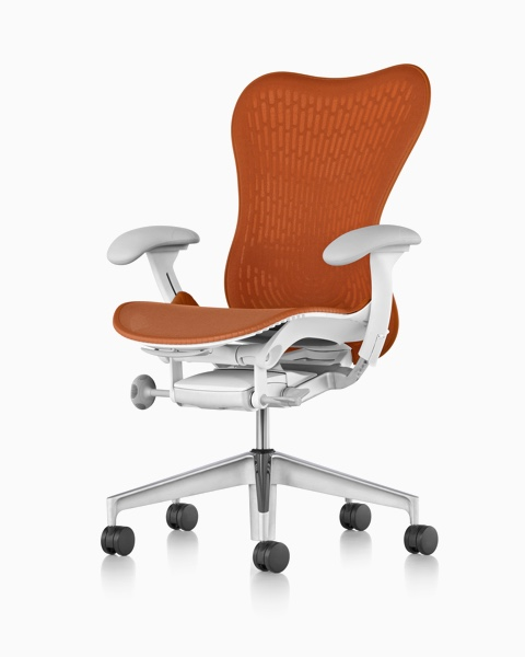Orange Mirra 2 office chair, viewed from a 45-degree angle and showing ergonomic controls.