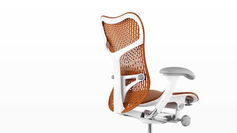 Orange Mirra 2 office chair, viewed from the back and side.
