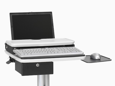 A height-adjustable Mobile Technology Cart, supporting a laptop and equipped with an optional lockable drawer.