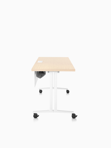 A Modesty Panel hangs from the front of a mobile rectangular table. Select to go to the Modesty Panel product page.