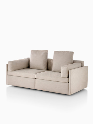 Beige Module sofa. Select to go to the Module Lounge Seating product page.