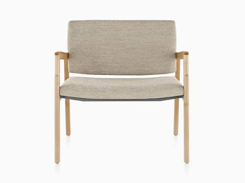 A Monarch Plus chair with a wide seat, beige upholstery, and solid maple frame, viewed from the front.