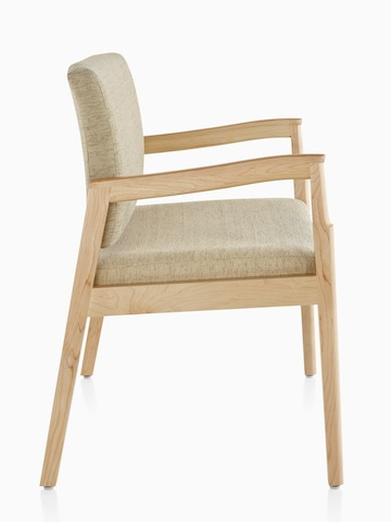 Profile view of a Monarch Plus chair with a wide seat, beige upholstery, memory foam seat, and solid maple frame.