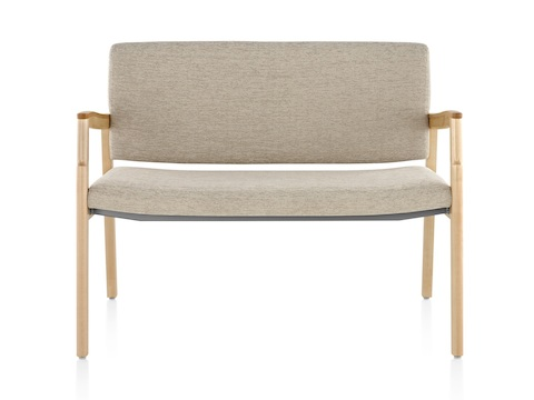 A Monarch Plus chair with an extra-wide seat, beige upholstery, and solid maple frame.