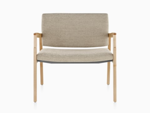 A Monarch Plus chair with a wide seat, beige upholstery, and solid maple frame.