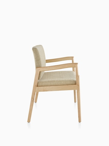 Profile view of a beige Monarch Plus chair with a wide seat. Select to go to the Monarch Plus Seating product page.